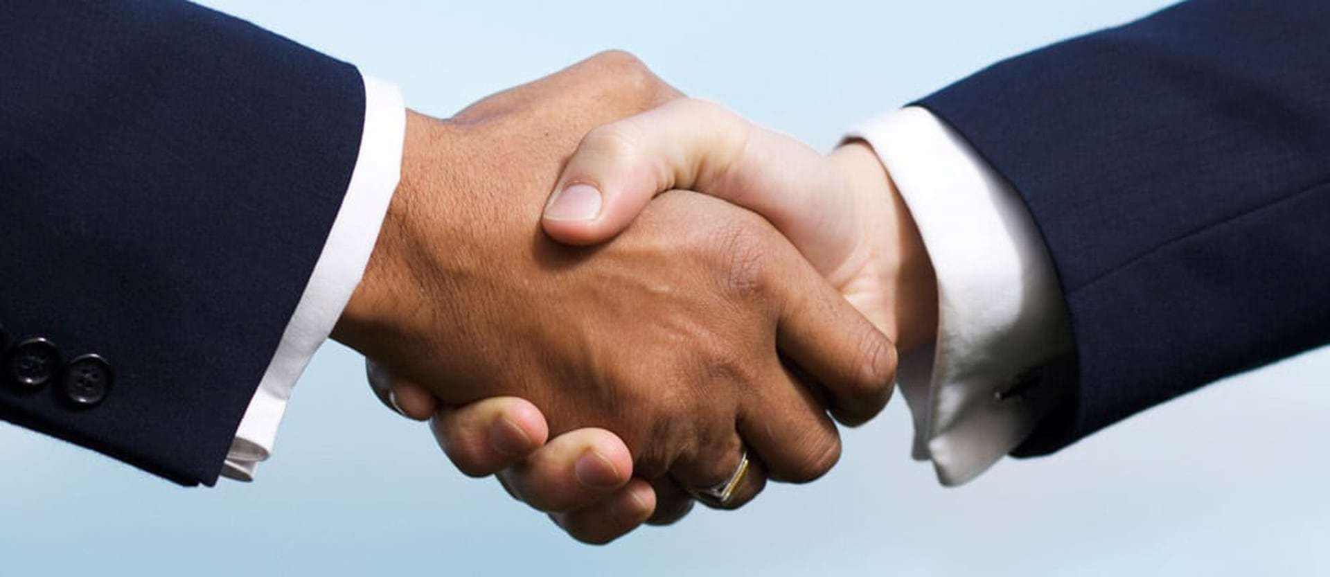 Handshake after Legal Settlement